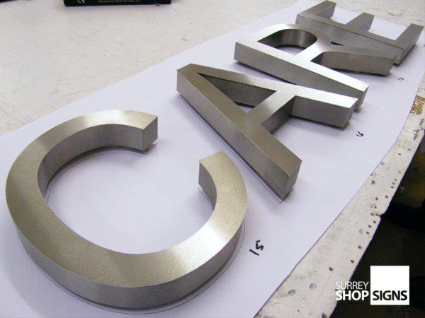 built up brushed steel letters