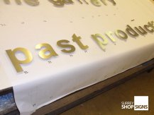 past production brushed gold all letters