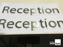 reception flat office sign