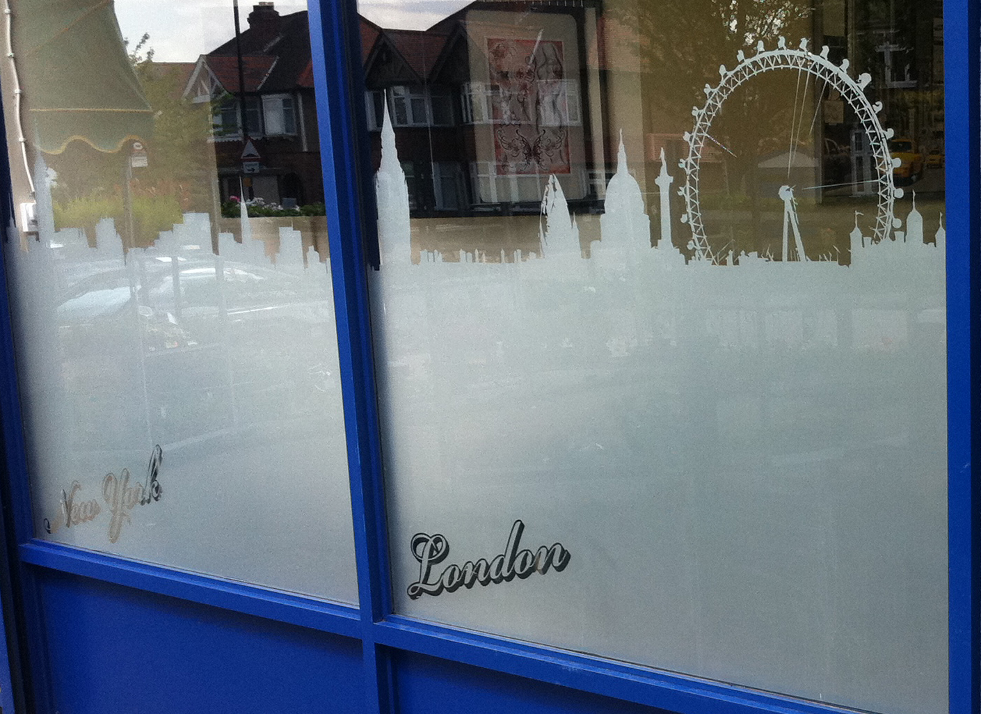 Window graphics vinyl window signs surrey shop signs for Vinyl windows company
